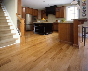 Continuous hardwood flooring (showing hickory species in photo) can blend rooms, making the space appear larger and open.