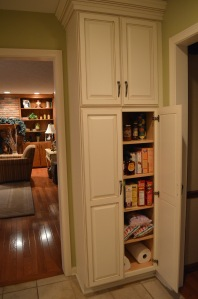 Here's a pantry cabinet added on a short wall between 2 doorways.