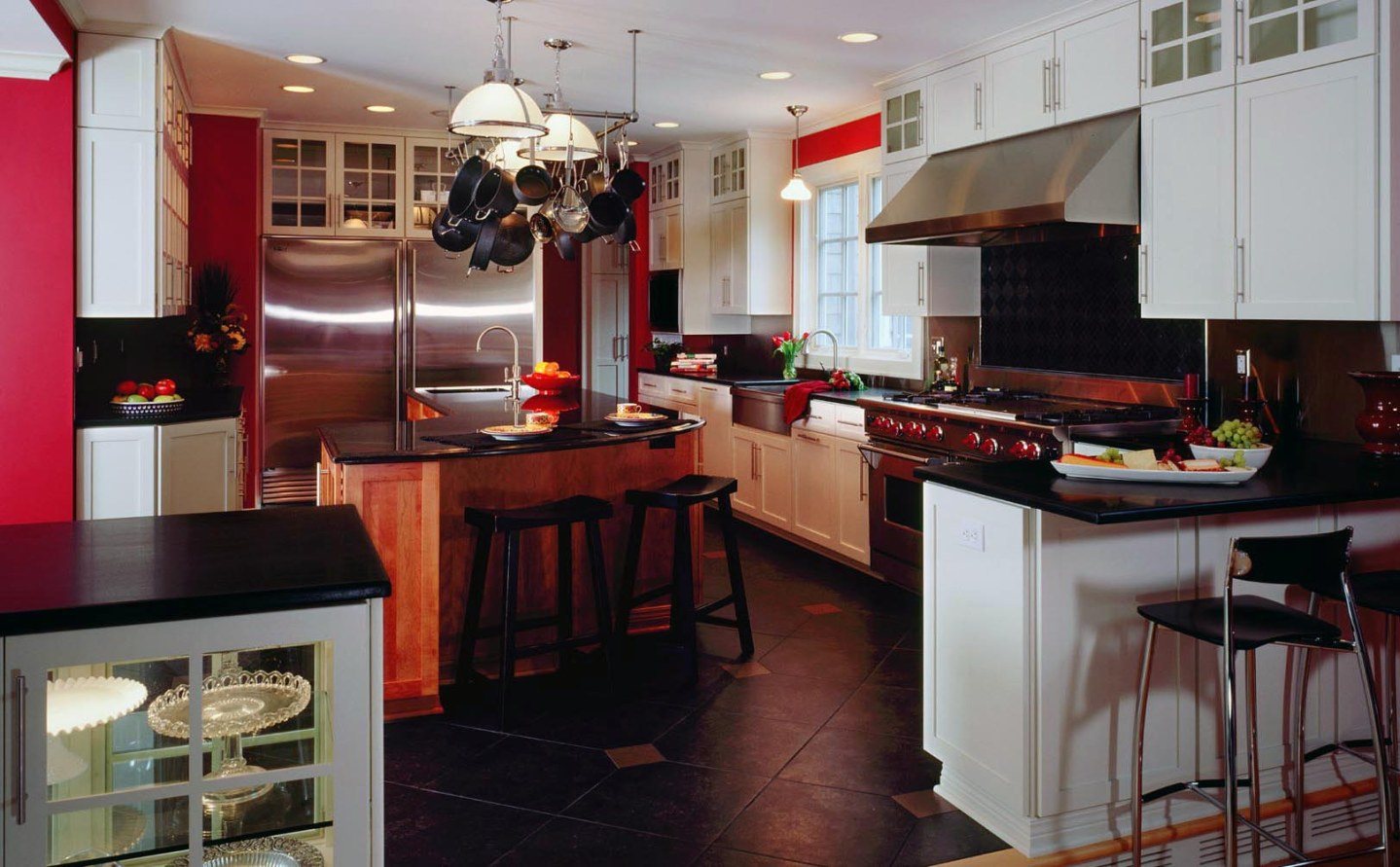 Black honed granite surfaces with white painted Mouser Custom Cabinets