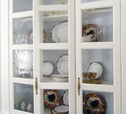 Glass doors are perfect to view colorful dishware.